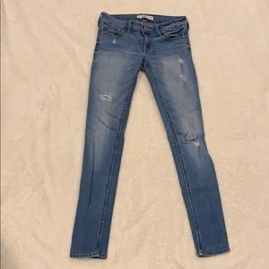 Medium/light wash distressed skinny jeans